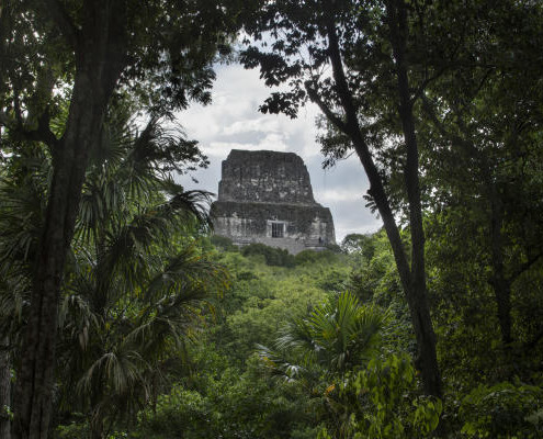 Temple IV, in the Mayan acheological site of Tikal is the tallest pre-Columbian structure still standing in the New World at 64.6 metres (212 ft) in height.  The pyramid was built to mark the reign of the 27th king of the Tikal dynasty, Yik'in Chan K'awiil and completed about 741 A.D.  Tikal National Park, Guatemala.. (Photo by: Jon G. Fuller/VW PICS/UIG via Getty Images)
